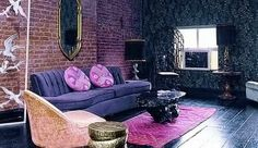 living room design with brick wall and purple fabrics, not big on the décor but the walls and floor combo are intresting