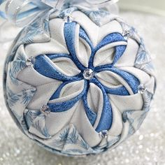 - a glittery blue & white Poinsettia ornament. Christmas Ribbon Crafts, Quilted Christmas Ornaments, Christmas Baskets, Handmade Christmas, Christmas Tree Decorations, Quilted Fabric Ornaments, Easter Egg Pattern, Fabric Balls, Fall Swags