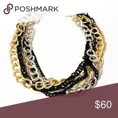 Multi strand chain link statement necklace Multi strand chain link statement necklace in silver, gold, and black 18-20 in. New With Tags. Boutique MSRP: $79.99 Khattie's Boutique Jewelry Necklaces