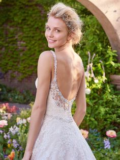 Rebecca Ingram - allison, This gorgeous ballgown features a layer of lace appliqués over tulle. A V-neckline and open back with lace illusion trim add hints of alluring romance. Accented with Swarovski crystal belt and embellished straps. Finished with covered buttons and zipper closure.