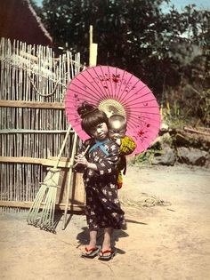 japanese parasols | Old Japan - Sister takes care of little brother for the day.