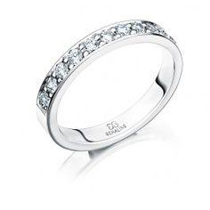 Smakfull förlovningsring/vigselring i 18k vitguld från Schalins i serien Passion. Ringen har 11 stycken diamanter infattade på totalt 0,40ct Wesselton SI samt är 3mm bred och 1,9mm hög.