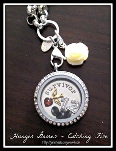 Hunger Games inspired Origami owl locket Http ://cassie.origamiowl.com Katniss Everdeen District 12