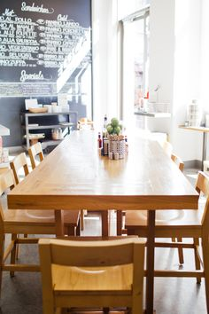 Communial table at Deluca's Italian Deli at The Americana at Brand.
