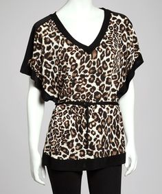 Take a look at this Ivory & Brown Belted Leopard Cape-Sleeve Tunic by Wrapper on #zulily today! $20 !!
