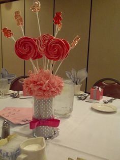 Lollipop centerpiece @kirstin- not the tall stuff but I like the foof at the bottom