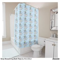 Grey Hound Dog Bath Time Shower Curtain. This is a drawing of a doe-eyed grey hound dog in a bath tub with bubbles and a rubber duck on its head.