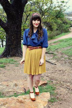 Blouse + skirt + shoes, colors, lipstick.