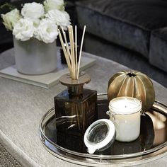 Ottoman styling detail shot. I love these @daylesfordorganic geranium candles�