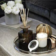 Ottoman styling detail shot. I love these @daylesfordorganic geranium candles…