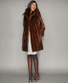 Layer luxuriously in the classic elegance of The Fur Vault's mink fur coat. | Real mink fur; lining: polyester | Professional fur clean only | Imported | Ranch and Scanbrown colors mink fur origin: De