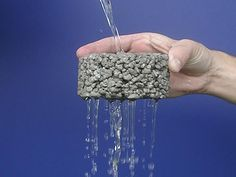 Porous Concrete is made with little or no sand and generally uses larger pea gravel, so the look is not as smooth as conventional concrete. It is available through most concrete suppliers.