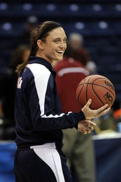 UConn guard Kelly Faris smiles at a teammate during warmups before taking on the Kentucky Wildcats in an Elite Eight game at the Webster Bank Arena.