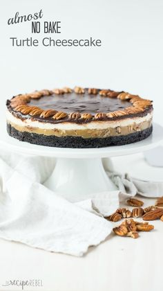 An Oreo cookie crust, a layer of pecans and caramel, a cheesecake ...