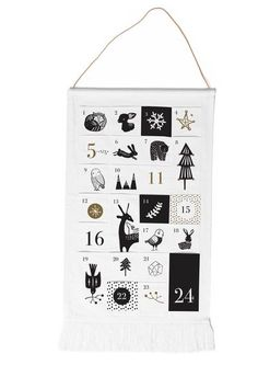 "DESCRIPTION   A beautiful new fringed Advent Calendar featuring pockets for counting down the days to your favorite holiday or event. Each pocket has a printed number and/or beautiful design with the iconic Wee Gallery black and white design style.   Final Sale Item31.5"" x 20""   DESIGNER   Click to view more items by Wee Gallery"