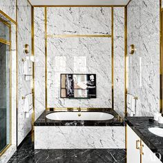 A luxe master bathroom  is clad in marble | archdigest.com