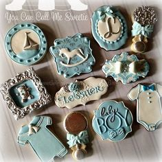 Nautical Theme Boy Sugar Cookies With Blue Royal Icing Oif Shop, Baby Jumper, Rattle, Ship, And Rocking Horse.