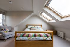 Dormer window loft conversion with skylights in South West London.