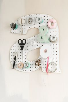Add a DIY pegboard letter to your workspace.