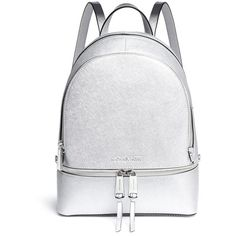 Michael Kors 'Rhea' small metallic saffiano leather backpack ($450) ❤ liked on Polyvore featuring bags, backpacks, metallic, studded backpack, day pack backpack, backpack bags, michael kors backpack and white studded backpack