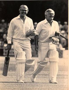 Prime Minister Bob Hawke and British Prime Minister John Major retire after batting against the Prince Edward School at the Harare sports ground in a Commonwealth Heads of Government charity match, Zimbabwe 1991.