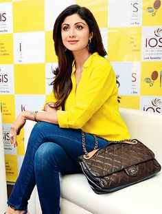 Shilpa Shetty in a vibrant yellow shirt and blue jeans outfit. #Bollywood #Fashion #Style #Beauty #Hot #Sexy