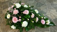 Funeral spray with carnations and germinis