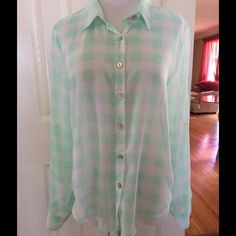 Sheer Blouse Boutique purchased. Worn once. Sheer green & white. Long sleeves that can be adjusted. 100% Polyester About A Girl Tops