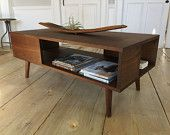 Fat Boy mid century modern coffee table with storage, black walnut & tapered wood legs.