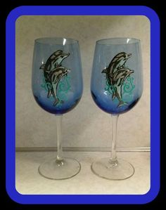Set of hand painted dolphin wine glasses