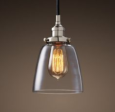 "Glass Cloche Filament Pendant Polished Nickel     $119         •Cast-aluminum fittings  •Finished with polished nickel  •Clear glass shade reveals the bulb and maximizes its light  •Uses our 1910 Squirrel-Cage Filament bulb (a 40W max. Type A bulb), included   •Hardwire  •Damp UL-listed  •8' cord is covered in black cloth; cord may be shortened  Dimensionsh  5½"" diam., 6¾"""