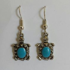 Small turtle-themed drop earrings with a teal shell accompanied by a lovely silver-coloured finish. Very lightweight and dainty. Perfect for the turtle lover in your life Small Turtles, Shells, Teal, Drop Earrings, Silver, Color, Jewelry, Conch Shells, Jewlery