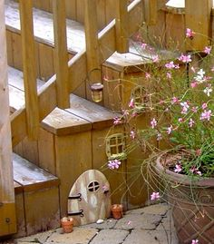 Fairies under the stairs ... so cute love the little lantern! Easy way to incorporate it or maybe on a garden pot?