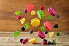 Multicolored flying macarons by Natasha on @creativemarket