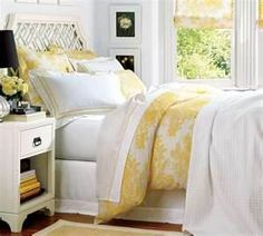 White vintage/country inspired bedside tables to go with yellow bedlinen