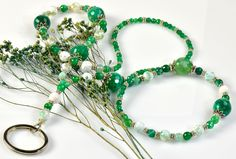 Green Desire Agate Lanyard - composed of green and white agate beads with small pewter spacers. Attached to a small metal ring at the end of the drop is a large oval metal ring that can hold an ID badge or keys. This ring can be easily detached if so desired. Our lanyards are handcrafted in America and made to last for years.  http://simplybeautiful2012.com/green-desire-agate-lanyard.html#