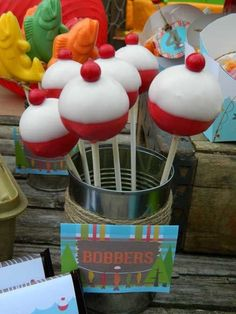 Fishing bobber cake pops at boy themed gone fishing party retirement fishing party cake pop