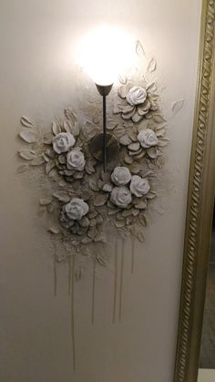 INSPIRATION FOR PLASTER MURAL THAT MOVES UP STAIRWELL AND AROUND LIGHTING