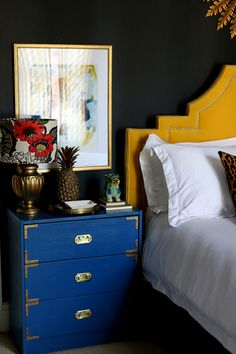 black bedroom with blue nightstand and yellow headboard Blue Nightstands, Dresser As Nightstand, Yellow Headboard, Ikea Shopping, Palette, Cafe Interior, Rustic Interiors, Cool Furniture, Decoration