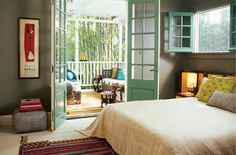 love this bedroom! Gray walls, green accents, and a simple linen bedspread