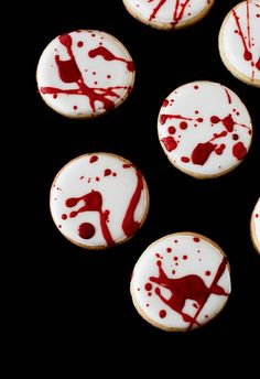 Look out DEXTER  Splatter cookies for Halloween  Bake sugar cookies in whatever shape you prefer.  Edge and flood the cookies in plain white royal icing.  Let dry completely overnight. Tint some of the leftover icing dark red.  Thin it to a consistency that splatters well. Lay cookies on a work surface covered in wax paper, parchment or foil. Splatter away using a clean paintbrush or the tines of a fork, until the cookies look as gross as you like.  Let dry.  Freak out your friends!