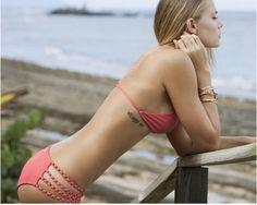 want that bikini... and tattoo.... and she's skinny
