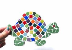 This darling turtle wall hook can be used in a childs room, in the bathroom or simply as a turtle display piece on any wall. Materials: Mini glass tiles will be used for the body with slightly larger glass tiles for the shell, I use an epoxy white grout to finish off the tiles. The back and sides are painted green. As wall decor, I will add a hook onto the back to let you hang on any wall, or add a single prong hook on front and let you hang on any wall and hang lightweight items from the…