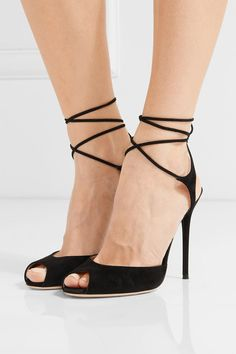 Gianvito Rossi is our go-to for elegant and understated sandals. Made from soft black suede, this pair sits on a stiletto heel and has ties that elegantly frame your foot. Wear them with gowns or cocktail dresses.  x