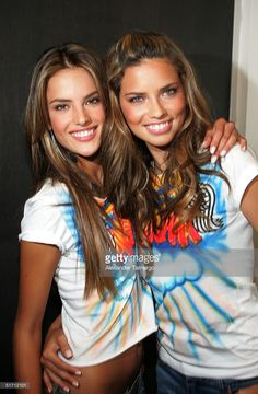 Victoria's Secret models Alessandra Ambrosio (L) and Adriana Lima pose backstage during the Miami Heat vs. Washington Wizards game at American Airlines Arena in Miami, Florida on November 9, 2004.