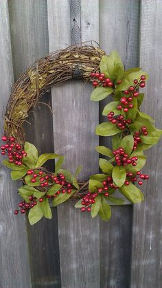 "18"" oval grapevine and red berries holiday wreath. $25.00, via Etsy."