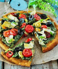 This is my Mediterranean Pumpkin Pizza, it captures the flavors of the Mediterranean plus Fall featuring lots of fresh vegetables!