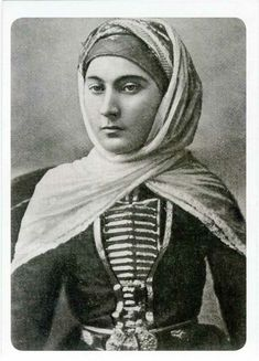 A Karaçay woman in traditional festive dress.  Ca. 1900.  The Karachays (or: Karaçay-Balkar) are a Turkic-speaking people of the North Caucasus region, mostly situated in the Russian Karachay-Cherkess Republic.