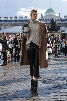 Leather ankle length trousers, a cozy sweater, and a trench complete this cool girls look. #LFW