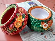 Planters frm recycled newspaper. With quilled flowers